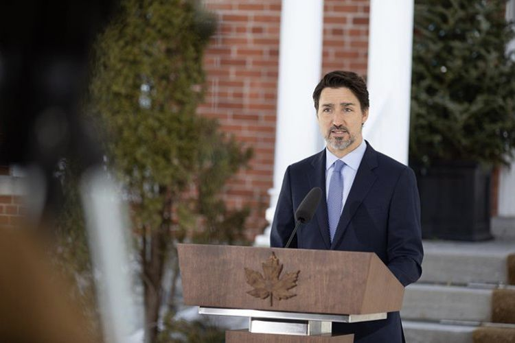 Justin Trudeau speaking at a podium - @justinpjtrudeau Instagram