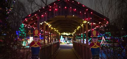 covered bridge decorated with christmas lights