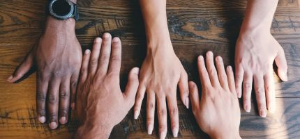 hands lined up on a table